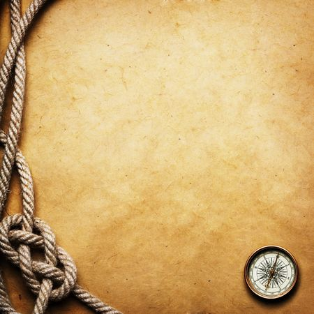 map compass: old compass and rope on grunge background