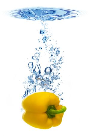 A background of bubbles forming in blue water after yellow pepper are dropped into it. photo