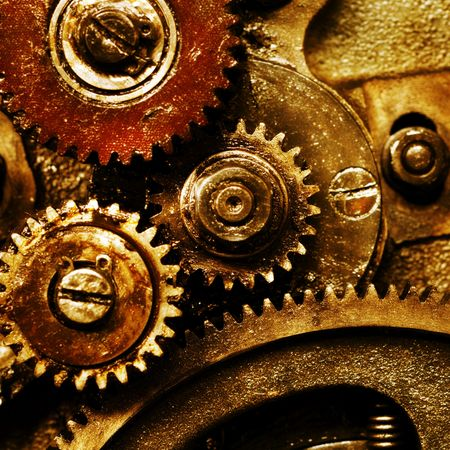 detailed view: A background of a detailed view of gears from a machine. Stock Photo