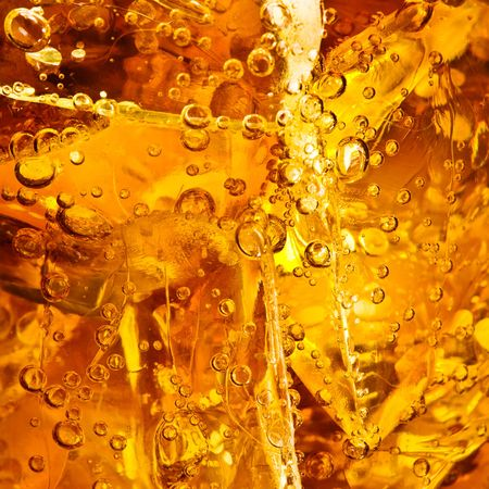 quenching: Close up view of the cola in glass