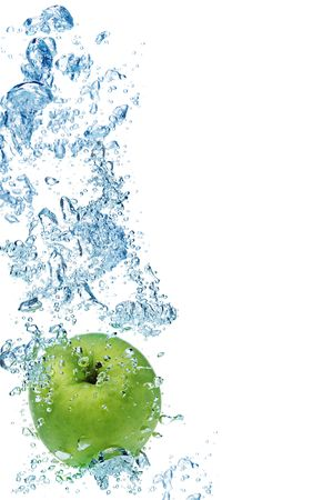 granny smith apple: Green apple under water with a trail of transparent bubbles. Stock Photo