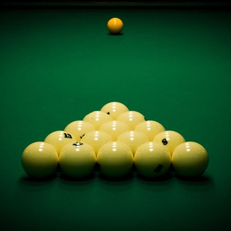 poolball: Yellow sphere on a billiard table in a night club Stock Photo