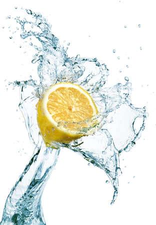 dropped: lemon is dropped into water splash
