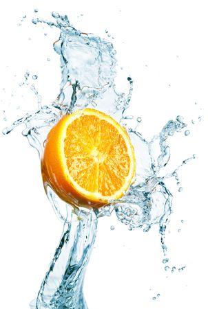 dropped: orange is dropped into water splash on white