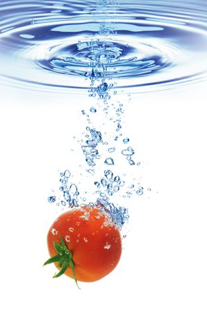 bubbling: A tomato splashing into water against a white background.