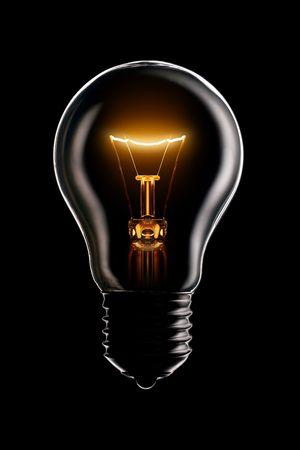 Glowing lamp on black background Stock Photo