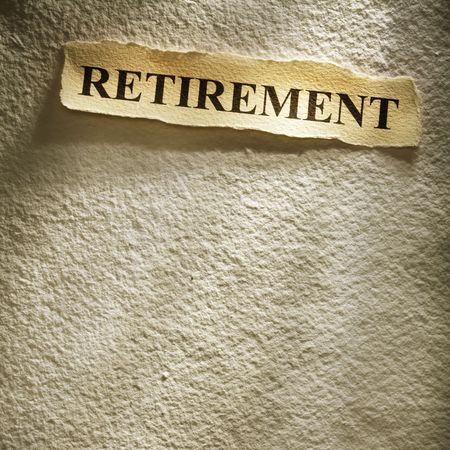 headline retirement on the old paper backgroune Stock Photo - 4586991