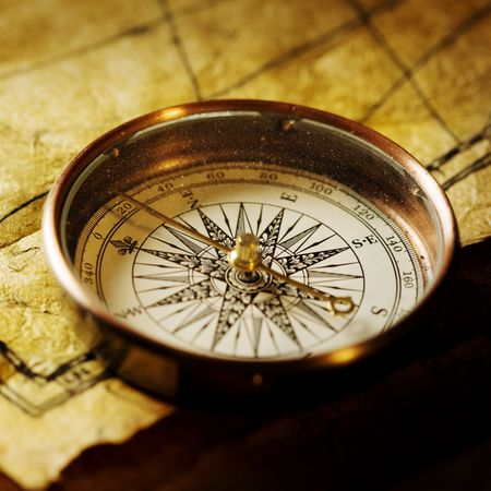 explore: Close up view of the Compass on the old paper background Stock Photo