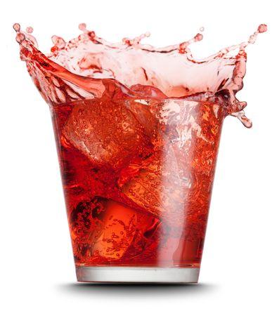 red beverage splashed on isolated on white background photo
