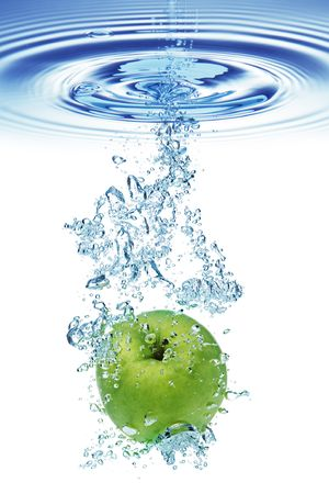 pome: Green apple under water with a trail of transparent bubbles. Stock Photo