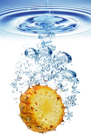 Bubbles forming in blue water after pineapple is dropped into it. Stock Photo - 4714246