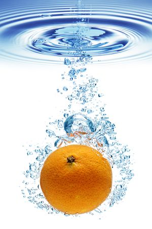 orange splash: A background of bubbles forming in blue water after orange is dropped into it.