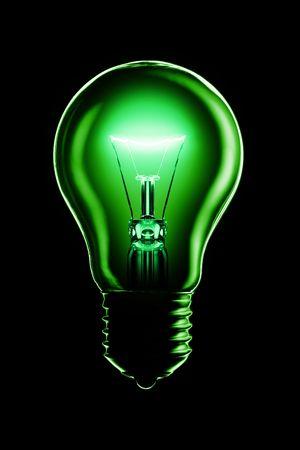 Glowing lamp on black background photo