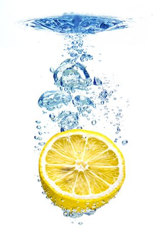 A background of bubbles forming in blue water after lemon is dropped into it. Stock Photo