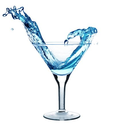 Martini being poured in a martini glass; isolated on a white background.