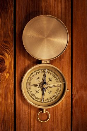 Close up view of the compass on old wood board Stock Photo - 4883287