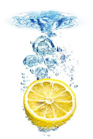 refreshing: A background of bubbles forming in blue water after lemon is dropped into it. Stock Photo
