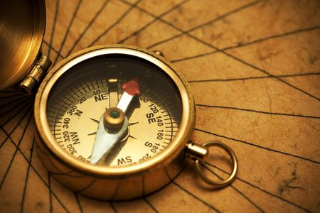 Close up view of the compass on old paper Stock Photo - 4889537
