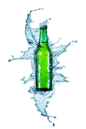 beer bottle being poured in a water on white photo