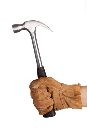 A hand holding a hammer isolated on white background photo