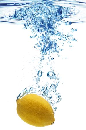icecubes: A background of bubbles forming in blue water after lemon is dropped into it. Stock Photo