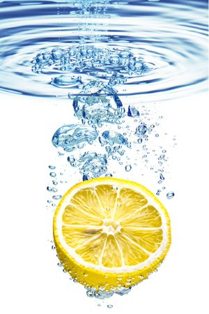 A background of bubbles forming in blue water after lemon is dropped into it. photo