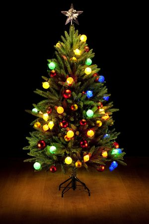 Christmas Tree and Gifts. Over black background photo