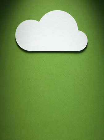 cloud cutted from paper lies on the paper background photo