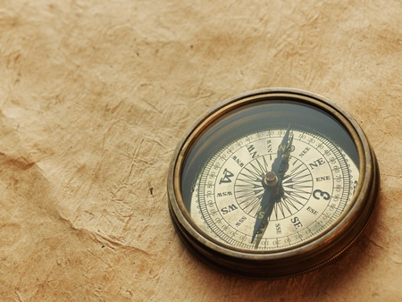 compass on the background of an old paper photo