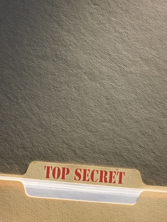 Top secret file folder on background photo