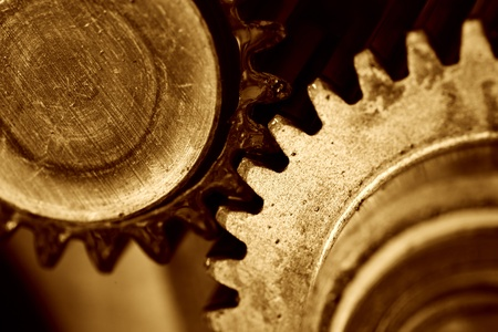 A background of a detailed view of gears from a machine. photo