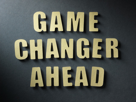 feels: The word Game Changer Ahead in cut out paper letters on paper background Stock Photo