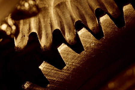 cog wheels: A background of a detailed view of gears from a machine. Stock Photo