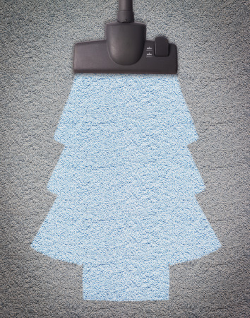 vacuum cleaner on the floor showing christmas tree photo