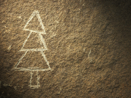 rock painting: rock painting of christmas tree on stone textured surface