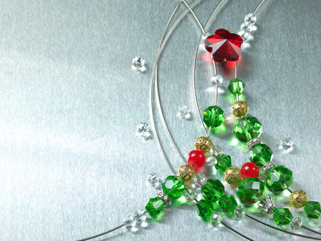 Christmas tree from color beads on metal plate photo