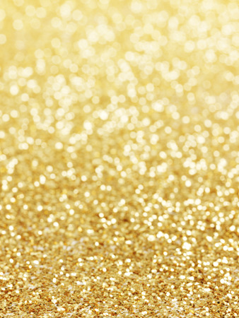 gold dust: golden background of defocused abstract lights. golden bokeh lights.