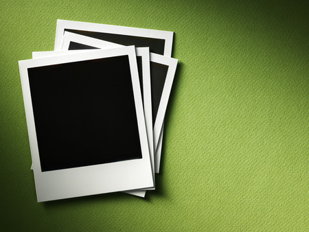 polaroid style photo frames on cardboard Stock Photo