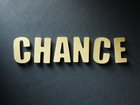 chances: The word Chance in cut out paper letters on paper background