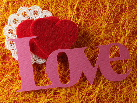 papercraft: Holidays card with heart as a symbol of lovevalentines day card with word love and heart Stock Photo