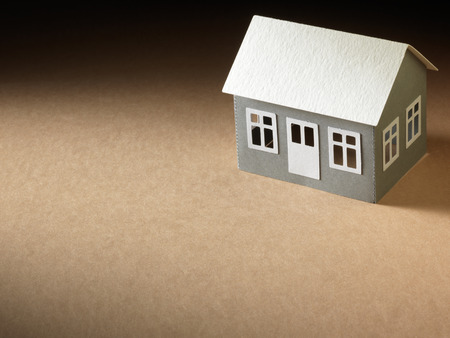 paper house on the cardboard surface photo