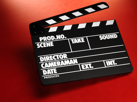 Clapper board on red background Stock Photo