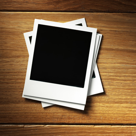 instant photo frame on wood background photo
