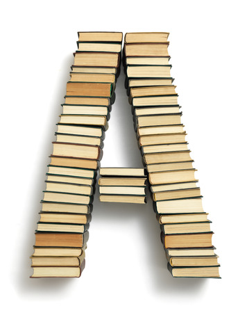 spines: Letter A formed from the page ends of closed vintage hardcover books standing on a white background