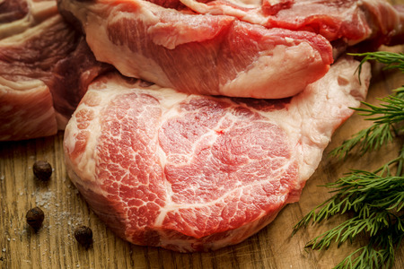 sizzling: Close up Raw Fresh Meat Slices on Wooden Chopping Board. Ready for Cooking Main Dish Stock Photo