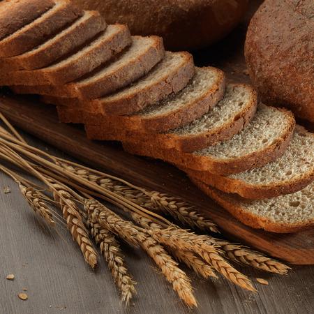 wheat grain: fresh bread on the wooden board