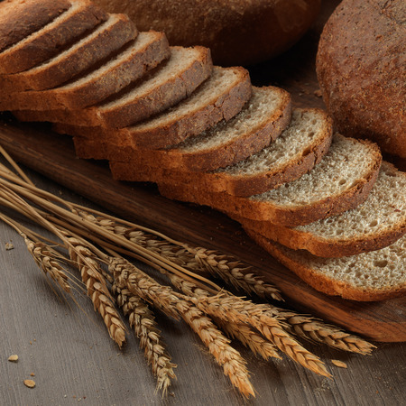 healthy grains: fresh bread on the wooden board