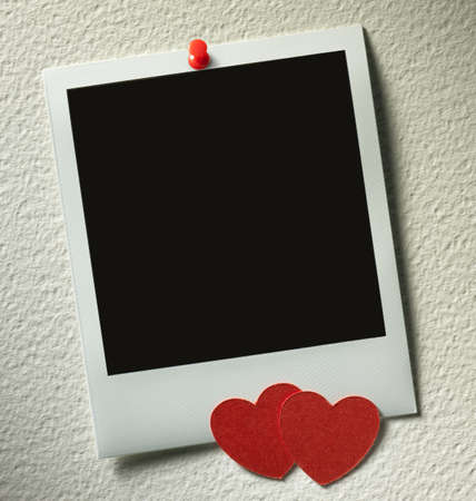 paper pin: polaroid style photo frames on paper background with paper heart