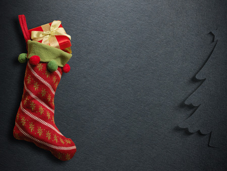 christmas sock: Christmas sock with red gift box on paper background