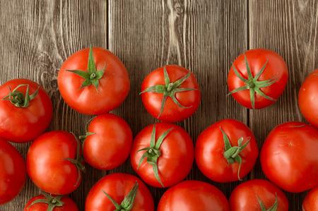 tomatos: Close-up of fresh, ripe tomatoes on wood background Stock Photo